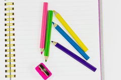 Colored pencils and a pencil sharpener Stock Photography