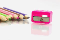 Colored pencils and a pencil sharpener Royalty Free Stock Photo