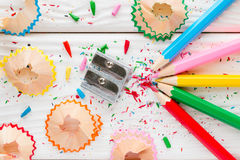 Colored pencils and pencil sharpener Royalty Free Stock Image