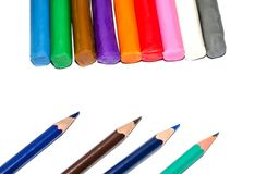 Colored pencils and plasticine are isolated on white royalty free stock image