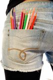 Colored pencils in a pocket of jeans Royalty Free Stock Images