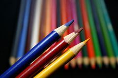 Colored Pencils (primary colors). A variety of colored pencils featuring the primary colors royalty free stock photo