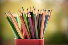 Colored pencils for pupils and children to paint or draw stock photos