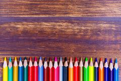 Colored pencils put in row flat lay stock photography