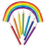 Colored pencils and rainbow Stock Photos