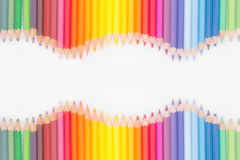 Colored pencils in rainbow order on white background. Royalty Free Stock Photography