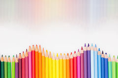 Colored pencils in rainbow order on white background. Royalty Free Stock Photos