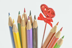 Colored Pencils and red heart  Royalty Free Stock Photography