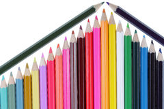 Colored pencils resembling a part of a house with a roof Royalty Free Stock Photo