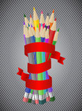 Colored pencils with ribbon Royalty Free Stock Image