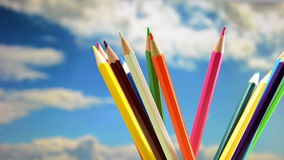 Colored pencils, rotation in the background the sky. Stock Image