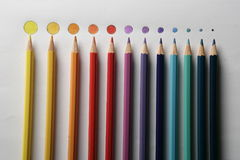 Colored pencils on rounded disk as colored points,. In a gradual dimension, from big to little Royalty Free Stock Photos