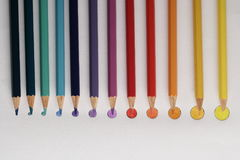 Colored pencils on rounded disk as colored points,. In a gradual dimension, from big to little Royalty Free Stock Image