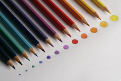 Colored pencils on rounded disk as colored points,. In a gradual dimension, from big to little Royalty Free Stock Photo