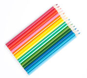 Colored pencils in a row. Shot on the white background stock photography