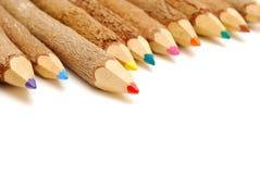 Colored pencils in a row Stock Photos