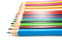 Colored pencils in a row Stock Photo