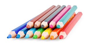 Colored pencils in row. On white background royalty free stock images