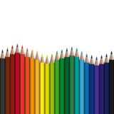 Colored pencils in a row. With endless wave stock illustration