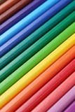 Colored pencils in a row forming a background Stock Photo