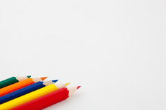 Colored pencils in a row. Colored pencils lined up in a row, on a white background Stock Images