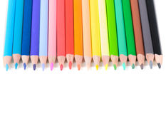 Colored pencils on row Stock Images