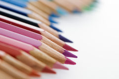 Colored pencils in a row wavy Royalty Free Stock Photos