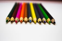 Colored pencils row on white background stock photo