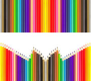 Colored pencils in rows Royalty Free Stock Image