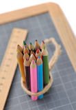 Colored pencils, rule and slate Royalty Free Stock Photos