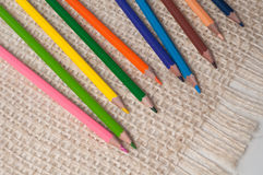 Colored pencils on sacking. Background Stock Images