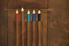 Colored pencils in satchel Stock Images