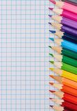 Colored pencils on the notepad royalty free stock photos