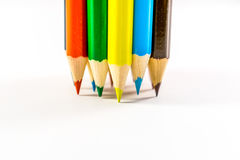 Colored pencils. School supplies colored pencils in a row , isolated on a white background Stock Image