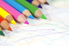 Colored pencils and scribbles. Line of colored pencils with scribbled paper Stock Image