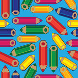 Colored pencils on seamless pattern Stock Photography