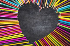Colored pencils shaped love sign Royalty Free Stock Photos