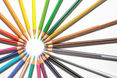 Colored pencils and sharp in circle Stock Images