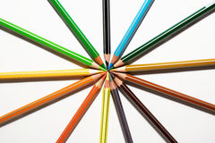 Colored pencils and sharp in circle Stock Photos