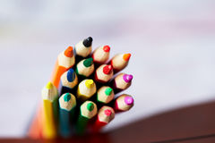 Colored pencils , sharpened, tightly gathered. Macro Stock Images