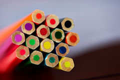Colored pencils , sharpened, tightly gathered. Macro Stock Photo