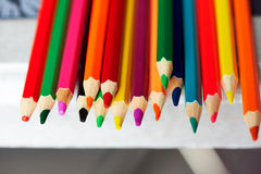 Colored pencils , sharpened, tightly gathered. Macro Royalty Free Stock Images