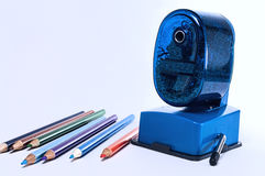 Colored pencils and sharpener royalty free stock photography
