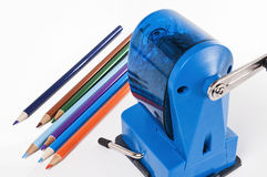 Colored pencils and sharpener royalty free stock photo