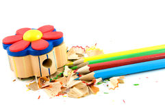 Colored pencils with sharpener and shaves Royalty Free Stock Photo