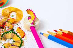 Colored pencils, sharpener and shavings Stock Photo