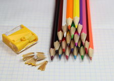 Colored pencils and sharpener Stock Image