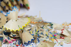 Colored pencils. Shavings from pencils. Located on a white background Stock Photography
