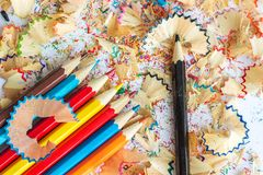 Colored pencils and shavings from pencils. Multicolored pencils and shavings from pencils on a white background Stock Photo