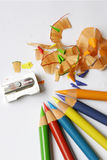 Colored Pencils, Shavings and Sharpener Royalty Free Stock Photography